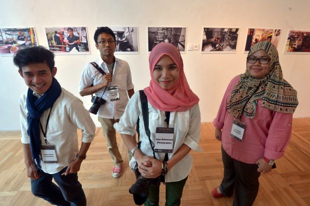 Eye-opening pictures: Some of the photographers behind the enlightening exhibition (from left) Ruffey Rahman, Sam, Anne and Zarith Zulkifli.