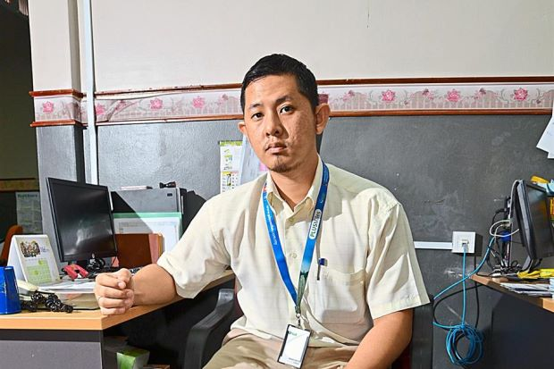 Back at work: Thanks to Socso, Haffiz now embraces his new lease on life as a management assistant.