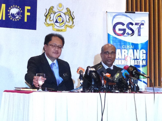 Datuk Seri Alias Ahmad (left) says the service charge was introduced to replace the tipping system, to compensate for low salary of workers as some hotels still pay their workers as low as RM130 a month. ― File pic