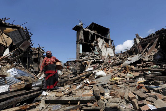 A woman walks past collapsed houses following the earthquake in Bhaktapur, Nepal(Reuters/Adnan Abidi)