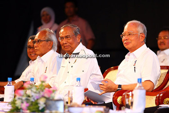 (From right) Najib and Chief Minister Datuk Patinggi Tan Sri Adenan Satem applauded by some 5,000 people who packed the main hall of BCCK at the start of the national-level Workers' Day celebration last Friday. — Photo by Chimon Upon