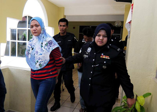The married couple were charged in the Selayang sessions court with grievously injuring the 22-year-old maid, using metal rods and a rotan.