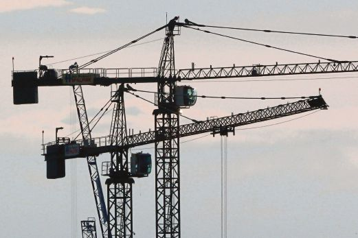 (File pix) Cranes operate at a construction site. Reuters photo