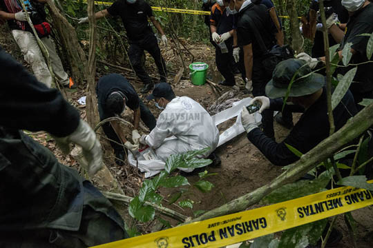 In May, the authorities stumbled upon mass graves and slave camps in the jungles of Wang Kelian, Perlis, after a regional crackdown on human traffickers. Malaysia's track record prompted the inclusion of a section on foreign labour in the Trans-Pacific Partnership Agreement. – The Malaysian Insider file pic, November 17, 2015.