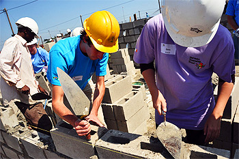 Building house laying bricks worker construction