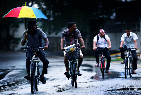 A group of foreign workers cycle home after work in Petaling Jaya. The Malaysian Trades Union Congress has expressed concerns over a plan to bring in 1.5 million workers from Bangladesh, saying it was against a policy to keep foreign workforce to 15% by 2020. – The Malaysian Insider file pic, November 6, 2015.