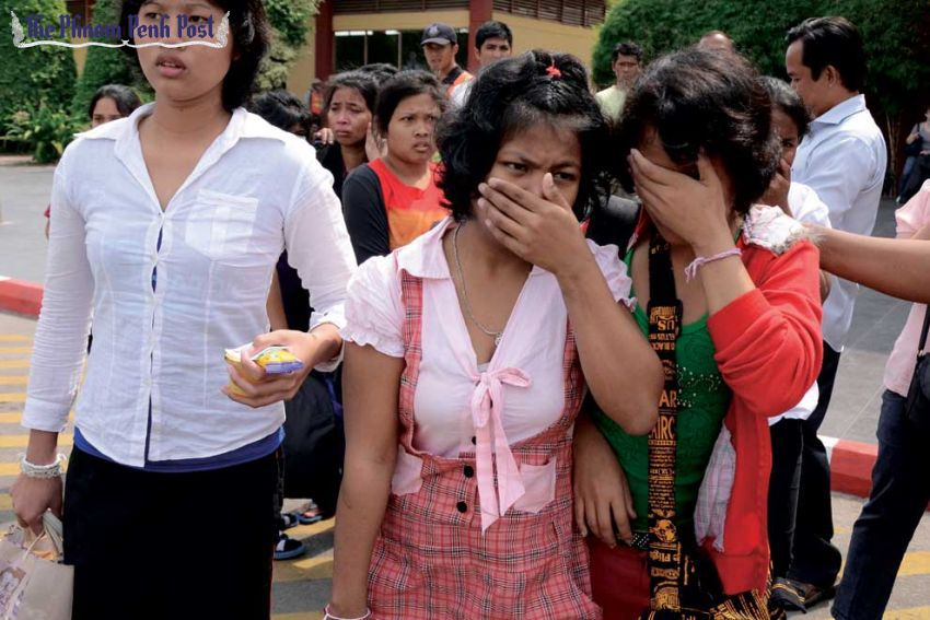 Cambodian maids arrive in Phnom Penh in February 2012 after returning from Malaysia, where they said they were abused by their employers. Pha Lina