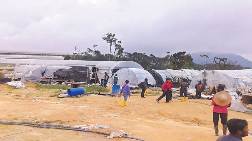 Malaysian immigration officials recently raid and destroy a camp in the remote mountains where Bangladeshi migrant workers live