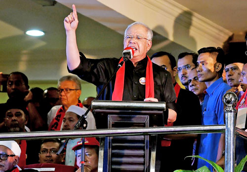 Malaysian Prime Minister Najib Razak gestures while addressing a Rohingya solidarity gathering in Kuala Lumpur on December 4. Photo: AFP