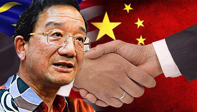 huang-huikang-malaysia-china-shakehand