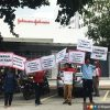 Johnson & Johnson agrees to take back 17 workers a day after protest